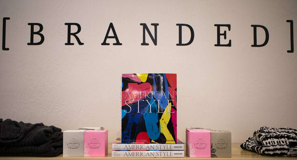 A shelf with sweaters and books is seen at Branded on Friday, Dec. 4, 2015 in Mill Valley, Calif.