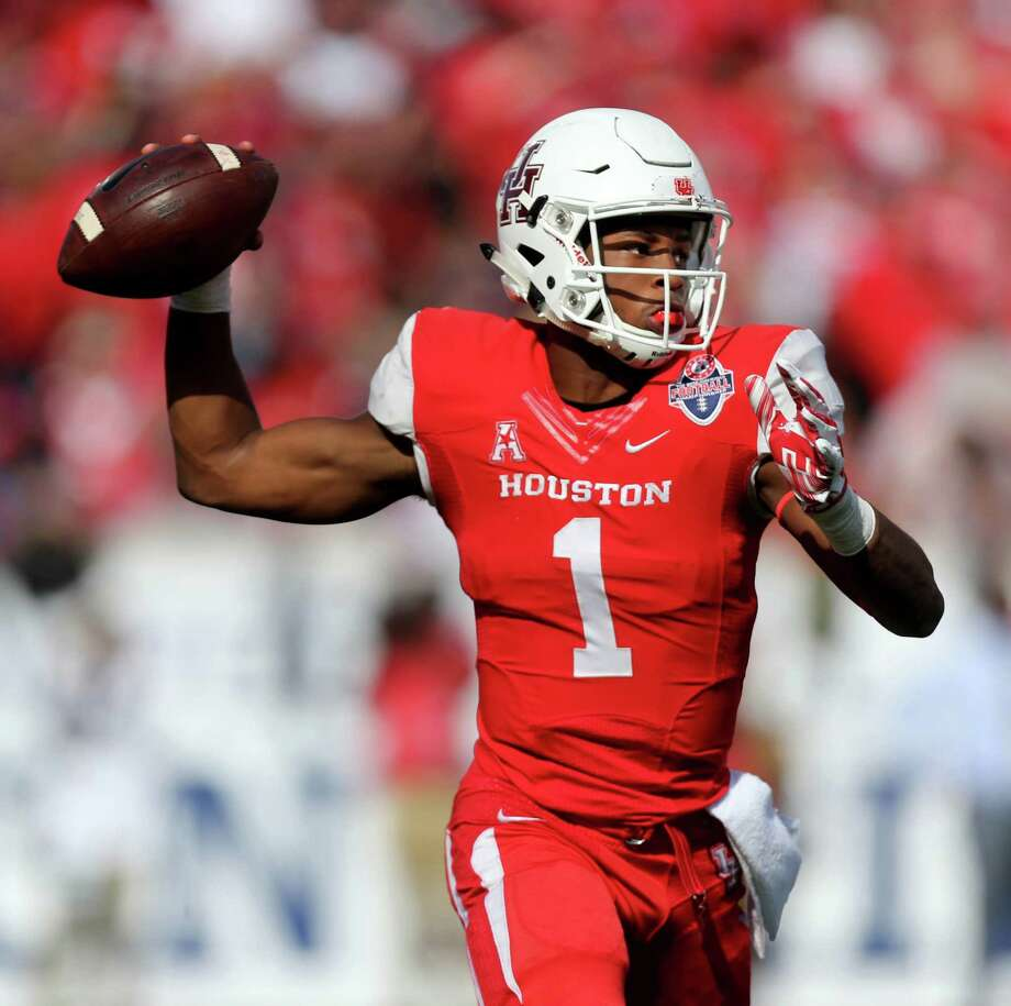 Houston Cougars quarterback Greg Ward Jr. (1) attempts a pass against the Temple Owls in the fourth quarter of the inaugural American Athletic Conference Championship game at TDECU Stadium Saturday, Dec. 5, 2015, in Houston, Texas. Cougars won 24-13. Photo: Gary Coronado, Houston Chronicle / © 2015 Houston Chronicle