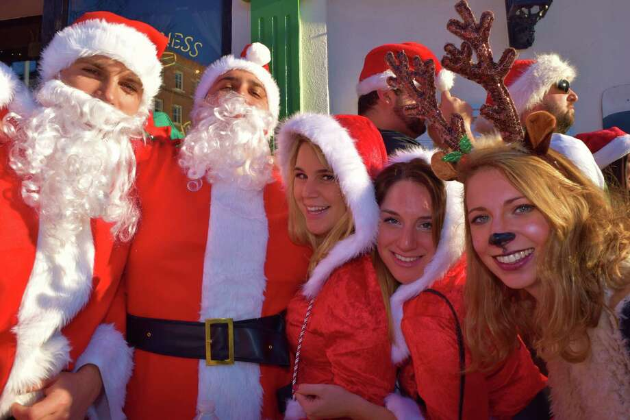 Stamford was taken over by Santas on December 5, 2015. Were you SEEN at Stamford SantaCon? Photo: Todd Tracy / Hearst Connecticut Media Group
