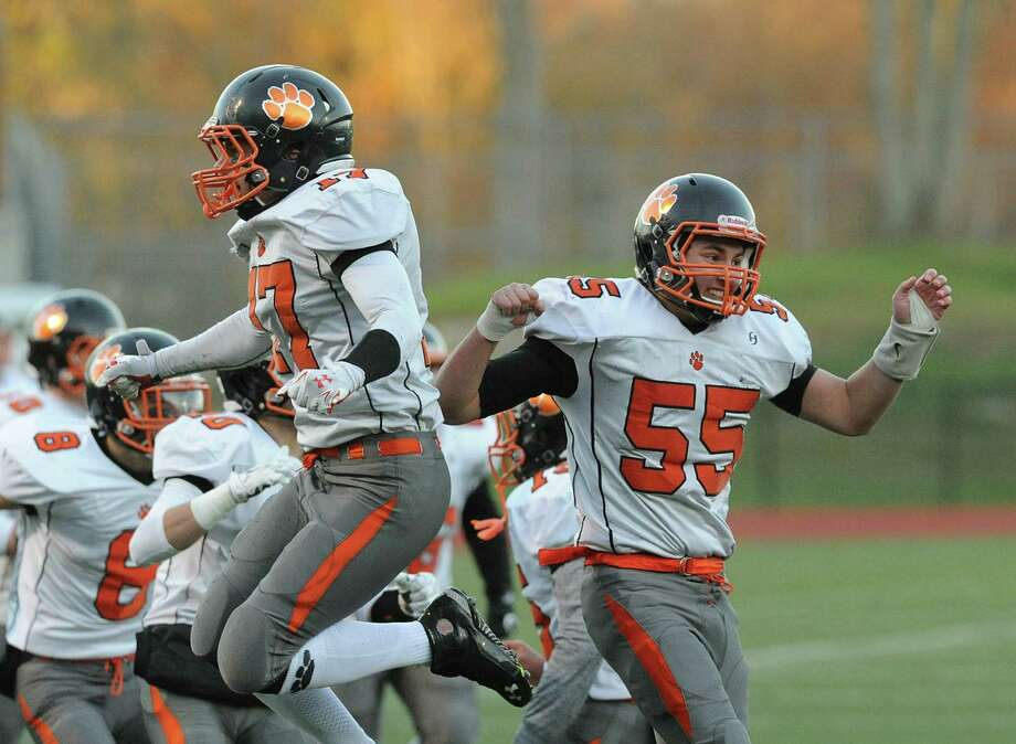 The Ridgefield High football team finished 7-2 this season. The Tigers are shown here playing at Greenwich last month. Ridgefield won the game, 37-7. Photo: Bob Luckey Jr. / Hearst Connecticut Media / Greenwich Time