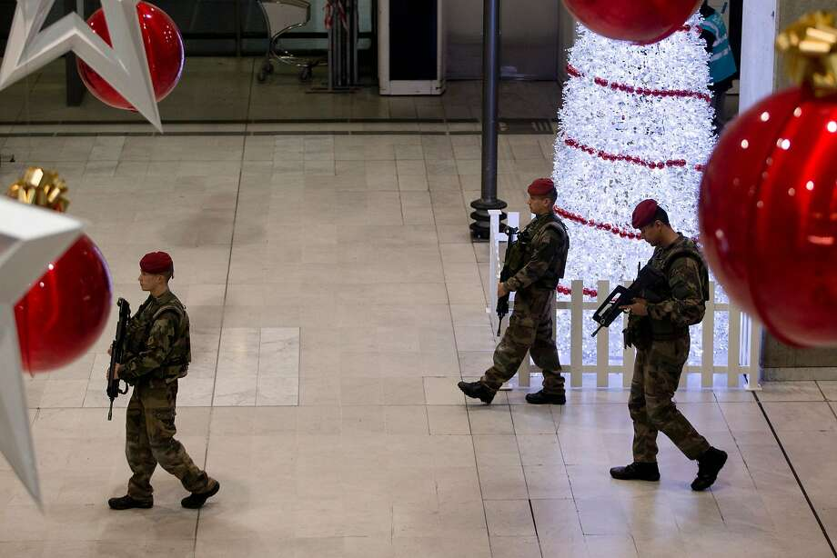 French soldiers patrol the Roissy-Charles-de-Gaulle airport, outside Paris on Dec. 3, 2015. Photo: Kenzo Tribouillard, AFP / Getty Images