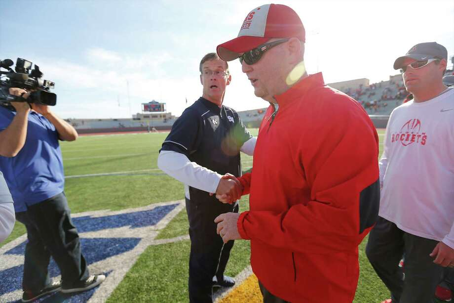 Judson head coach Sean McAuliffe (right) shakes hands with Smithson Valley head coach Larry Hill after the 6A quarterfinal game at Alamo Stadium on Saturday, Dec. 5, 2015. The Rockets defeated the Rangers, 38-24, to move onto the semifinals next week. (Kin Man Hui/San Antonio Express-News) Photo: Kin Man Hui, Staff / San Antonio Express-News / ©2015 San Antonio Express-News