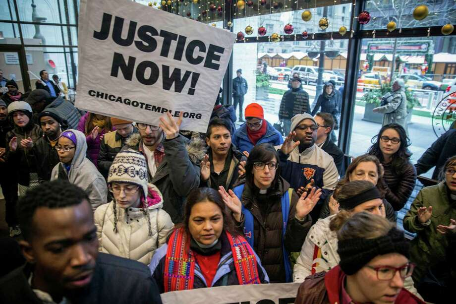 Clergy, labor leaders and supporters gather Thursday at the Cook County Administration Building in Chicago to demand the resignation of Cook County State's Attorney Anita Alvarez for taking 13 months to charge a police officer in the shooting of 17-year-old Laquan McDonald.  Photo: Rich Hein, MBR / Chicago Sun-Times