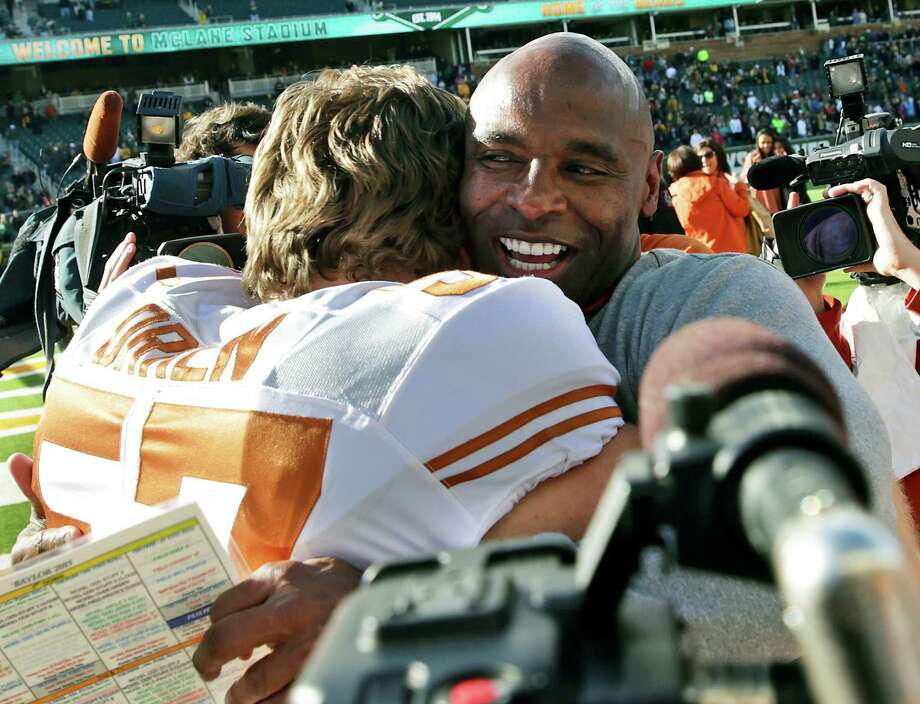Longhorn coach Charlie Strong hugs offensive lineman Clark Orren after their team wins in an upset 23-17 as Baylor hosts Texas at McClane Stadium in Waco on Dec. 5, 2015. Photo: Tom Reel /San Antonio Express-News / 2015 SAN ANTONIO EXPRESS-NEWS