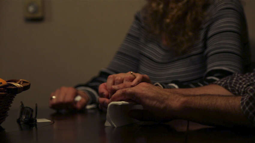 Kim and Tim Murdick, of West Sand Lake, clutch each other's hands as they recount the harrowing heroin addiction and heartbreaking death by fatal overdose of their son, Sean, 22, in a Florida treatment program on Sept. 28. (Photo by Nicole Van Slyke and Brian Flynn / WMHT)