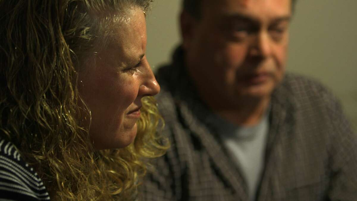 Kim and Tim Murdick talk in their West Sand Lake home's kitchen about their son, Sean, a co-captain of the Averill Park High School football team and 2011 graduate, who died on Sept. 28 at age 22 of a fatal heroin overdose in a treatment program in Florida after being turned away from programs in the Capital Region because of insurance policy limits and other issues. (Photo by Nicole Van Slyke and Brian Flynn / WMHT)