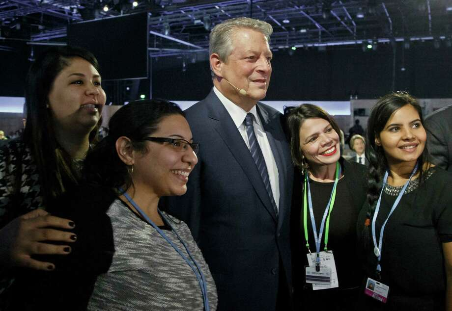 """Former US Vice President Al Gore poses for a photo with delegates during the""""Action Day""""at the COP21, United Nations Climate Change Conference, in Le Bourget north of Paris, Saturday, Dec. 5, 2015. President Francois Hollande is encouraging mayors of the world to get involved in fighting climate change and praising those that are already setting an example with low-emission buildings and public transport policies. (AP PhotoMichel Euler) Photo: Michel Euler, STF / AP"""