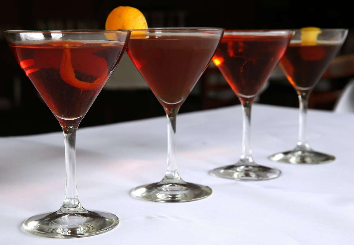 Negoni cocktails created by Kevin Correnti are displayed at his Trattoria Contadina restaurant in San Francisco, Calif. on Saturday, Dec. 5, 2015. From left: his original Negroni, the Boulevardiere, the Lady Hawk with prosecco and his Negroni with an all-European pedigree.
