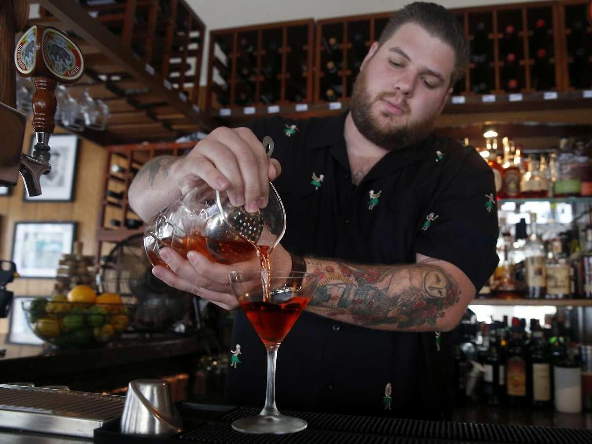 Kevin Correnti pours an original Negoni cocktail at his Trattoria Contadina restaurant in San Francisco, Calif. on Saturday, Dec. 5, 2015.