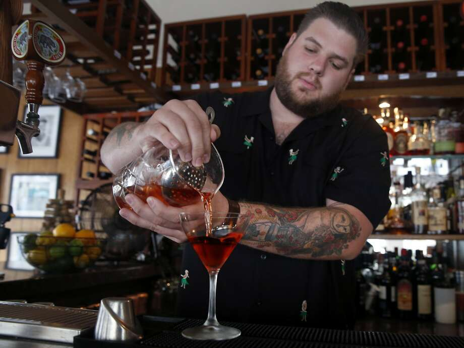 Kevin Correnti pours an original Negroni cocktail at his Trattoria Contadina restaurant in San Francisco. Photo: Paul Chinn, The Chronicle