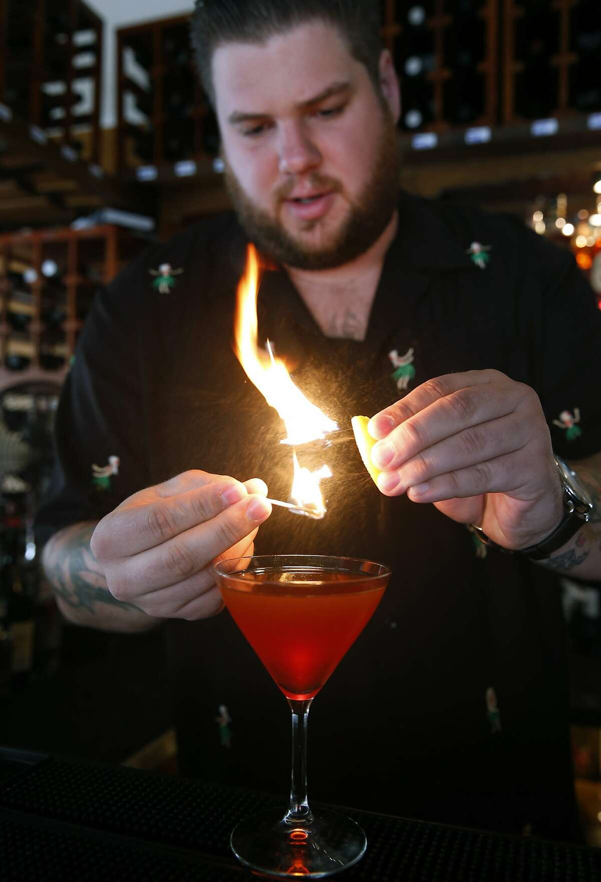 Kevin Correnti adds a citrusy flare to a Boulevardiere Negoni cocktail at his Trattoria Contadina restaurant in San Francisco, Calif. on Saturday, Dec. 5, 2015.