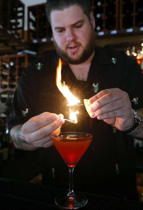 Kevin Correnti adds a citrusy flare to a Boulevardiere Negoni cocktail at his Trattoria Contadina restaurant in San Francisco, Calif. on Saturday, Dec. 5, 2015. Photo: Paul Chinn, The Chronicle