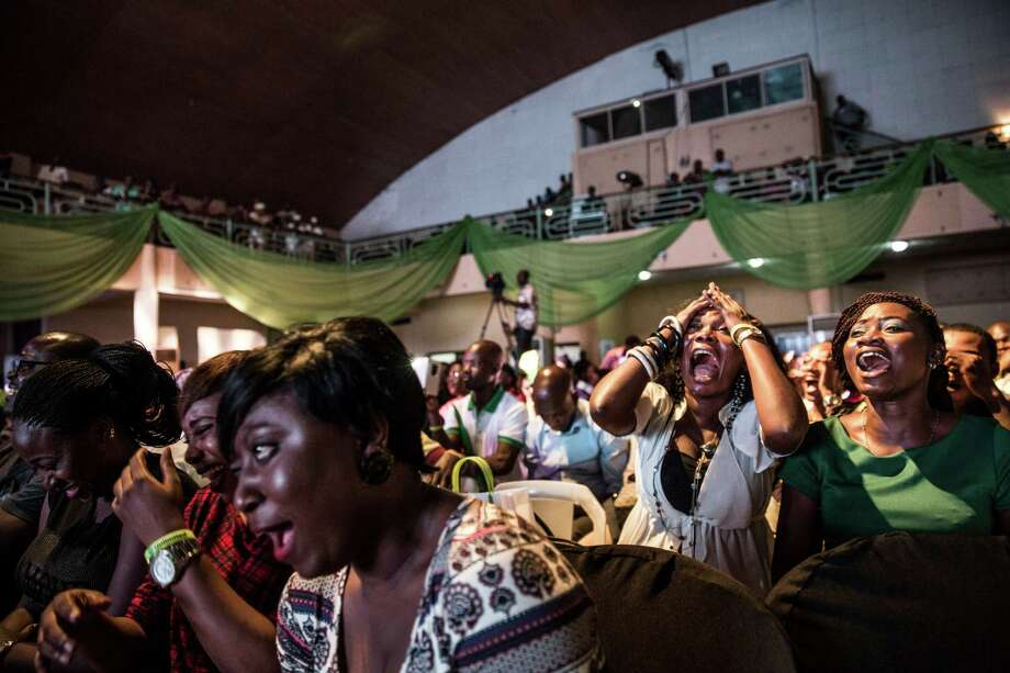 Audience members laugh during a comedy showcase on Oct. 3 in Lagos, Nigeria. In a nation troubled by corruption, blackouts and the scourge of Boko Haram, stand-up comics are mining misery for laughs and are more popular than ever.  Photo: GLENNA GORDON, STR / NYTNS