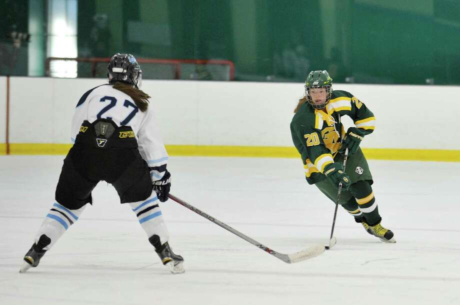 Greenwich Academy's Meghan Keating carries the puck up ice towards the Canterbury net. Photo: Michael Cummo / Hearst Connecticut Media / Stamford Advocate