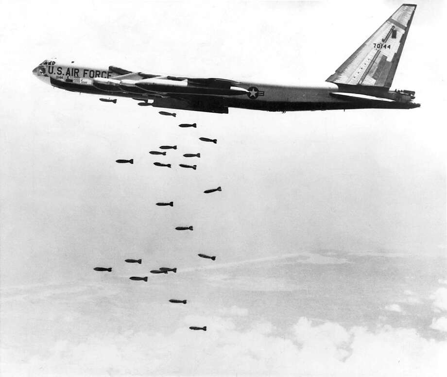 A U.S. Air Force strategic air command B-52 stratofortress drops a string of 750-pound bombs over a coastal target in the Republic of Vietnam during the Vietnam War in 1965. B-52s were scheduled for retirement years ago, but they are expected to keep flying until at least 2040.  Photo: US AIR FORCE, HO / US AIR FORCE