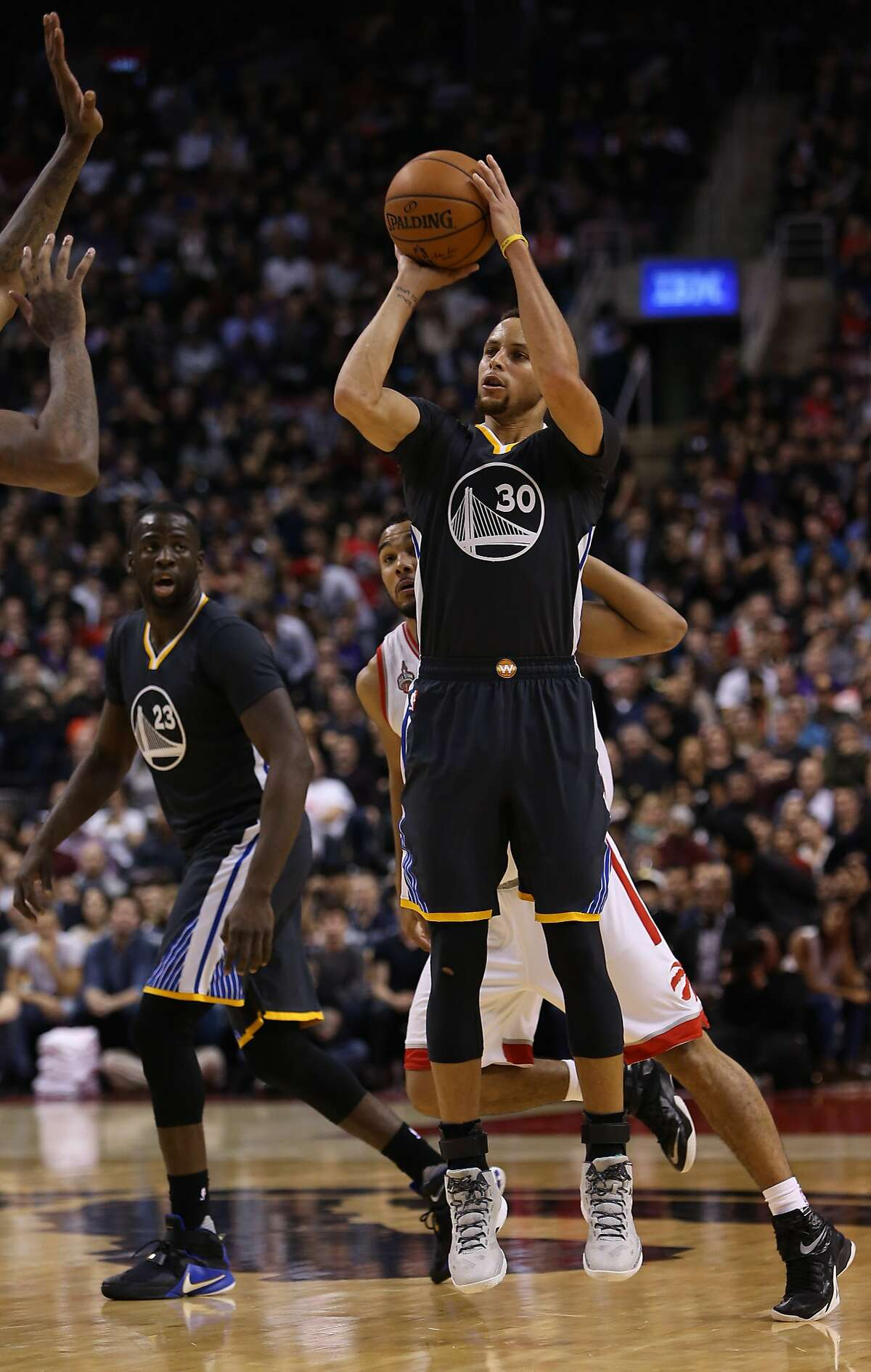 Stephen Curry #30 of the Golden State Warriors shoots the ball during an NBA game against the Toronto Raptors at the Air Canada Centre on December 05, 2015 in Toronto, Ontario, Canada.