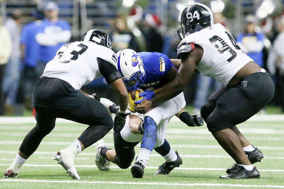 Steele's Terron Morris (left) Joshua Croslen (right) and Jayden Jackson (rear) combind to bring down Clemens' Marshawn Brown during the first half of their Class 6A Division II state quarterfinal playoff game at the Alamodome on Saturday, Dec. 5, 2015.  Steele beat Clemens 35-14.  MARVIN PFEIFFER/ mpfeiffer@express-news.net Photo: Marvin Pfeiffer, Staff / San Antonio Express-News / Express-News 2015