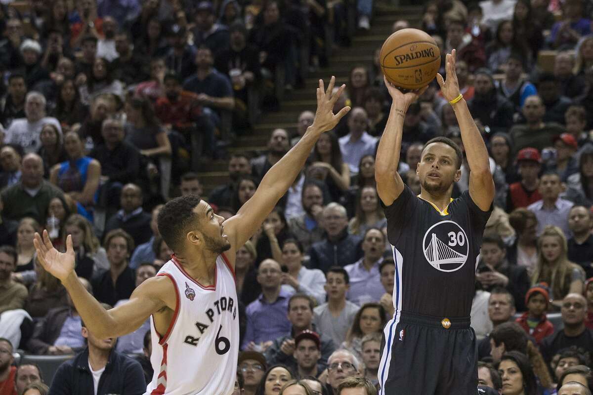 Golden State Warriors' Stephen Curry (30) shoots over Toronto Raptors' Corey Joseph during the second half of an NBA basketball game in Toronto, Saturday, Dec. 5, 2015.