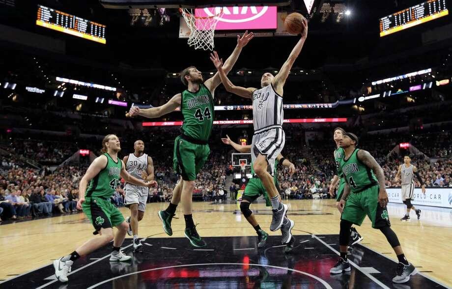 5086 x 3254~~$~~San Antonio Spurs guard Manu Ginobili (20) drives to the basket against Boston Celtics center Tyler Zeller (44) during the first half of an NBA basketball game, Saturday, Dec. 5, 2015, in San Antonio. Photo: Eric Gay, AP / AP