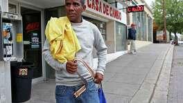Standing by the Cubanos en Libertad office in Laredo, Cuban refugee Eduardo Tamayo, 40, puts on his belt.
