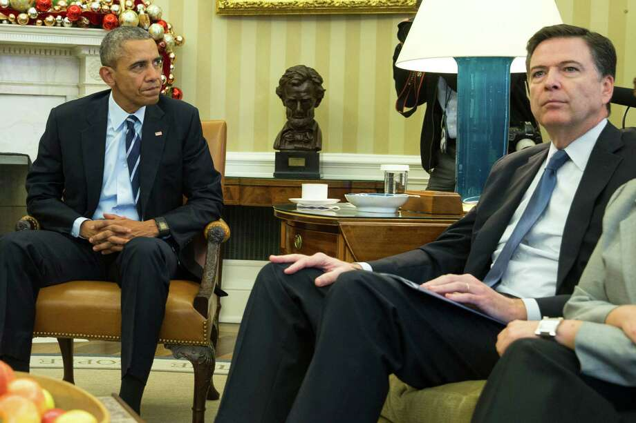 In this Dec. 3, 20156 photo, President Barack Obama sits with FBI director James Comey in the Oval Office of the White House in Washington, before making a statement on the mass shooting in San Bernandino, Calif.  The U.S. government's ability to review and analyze five years' worth of telephone records for the married couple blamed in the deadly shootings in California lapsed when the National Security Agency's controversial mass surveillance program was formally shut down, four days before the deadly California shootings.  Under a court order, those historical calling records at the NSA are now off-limits to agents running the FBI terrorism investigation even with a warrant.  (AP Photo/Evan Vucci) Photo: Evan Vucci, STF / AP