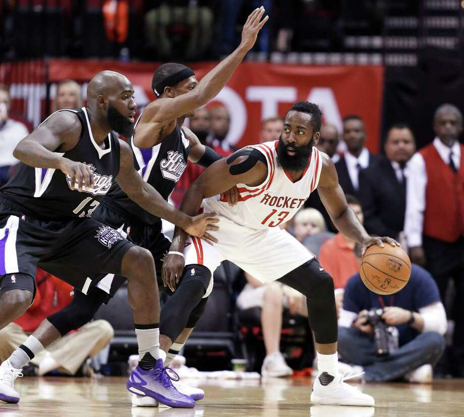 James Harden, who had 31 points, draws the attention of the Kings' Quincy Acy, left, and Rajon Rondo. Photo: Pat Sullivan, STF / AP