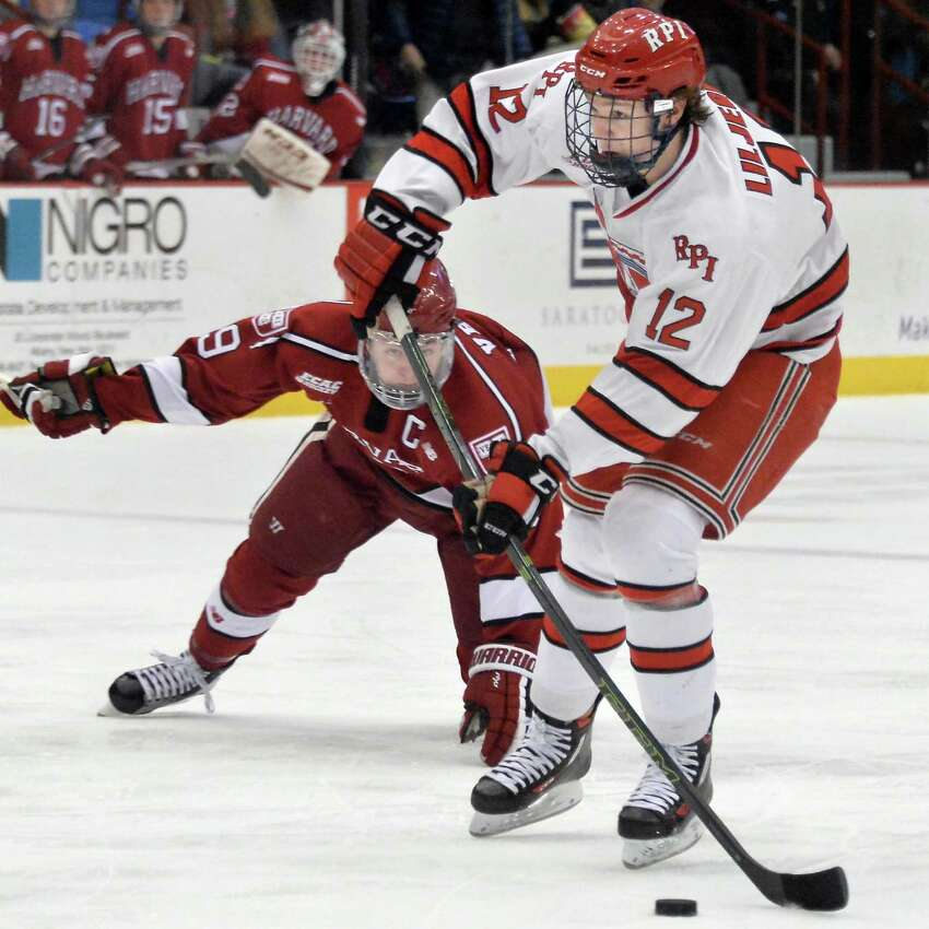 RPI's #12 Viktor Lilegren, right, gets off a shot as Harvard's #19 Jimmy Vesey defends during Saturday's game at the Houston Field House Dec. 5, 2015 in Troy, NY. (John Carl D'Annibale / Times Union)