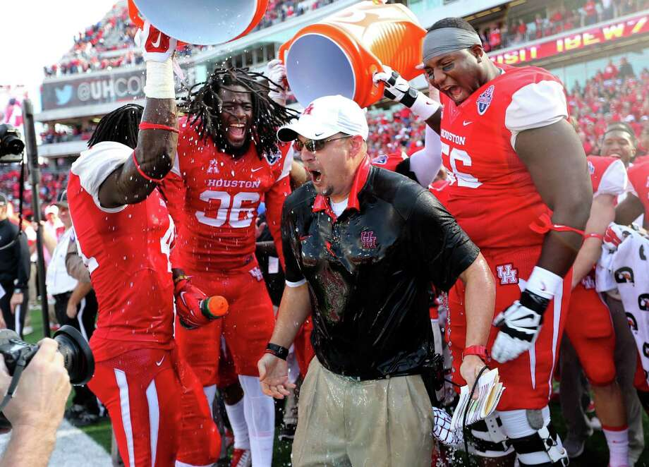 Coach Tom Herman earns the traditional soaking at the hands of the Cougars after UH beat Temple in the American Athletic Conference title game. Photo: Gary Coronado, Staff / © 2015 Houston Chronicle