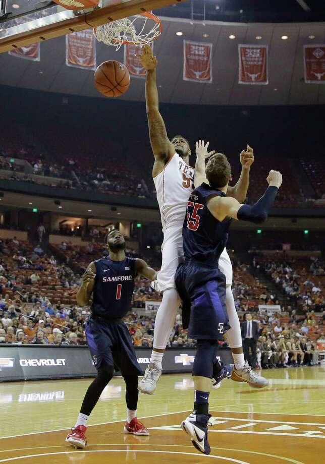 1554 x 2218~~$~~Texas center Cameron Ridley, center, scores over Samford forward Alex Peters (55) during the second half of an NCAA college basketball game Friday, Dec. 4, 2015, in Austin, Texas. Texas won 59-49. Photo: Eric Gay, AP / AP