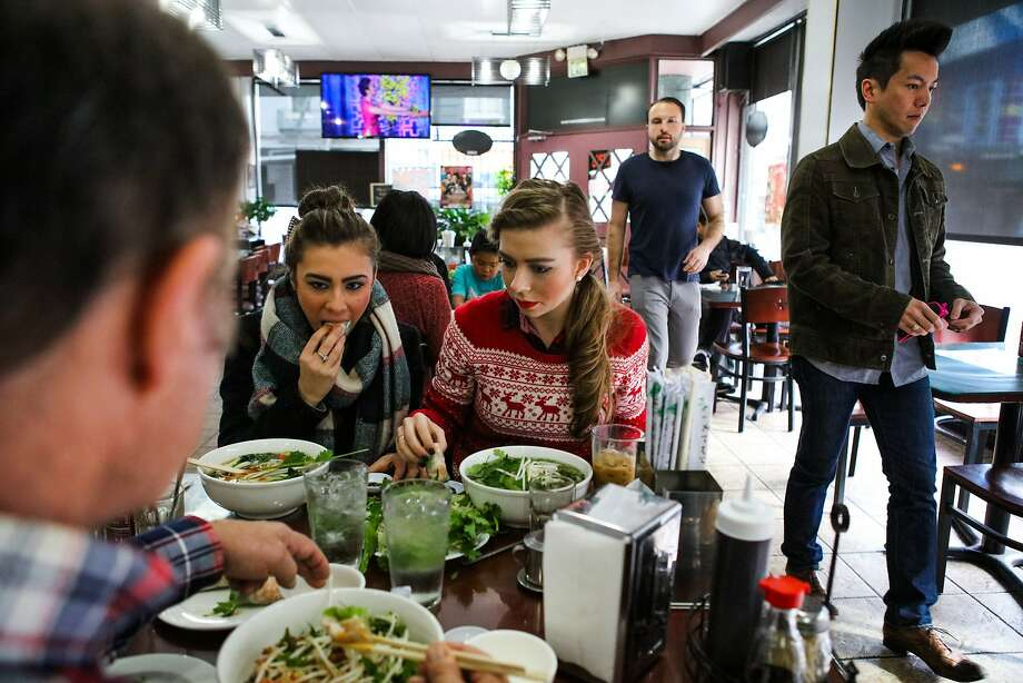 Sisters Tiffany Cerruti (left), and Kimberly Cerruti (center) eat lunch at Ha Nam Ninh restaurant in San Francisco, California on Saturday, December 5, 2015. Photo: Gabrielle Lurie, Special To The Chronicle