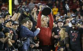 Stanford's head coach David Shaw holds the championship trophy high after beating the USC Trojans 41-22 in the NCAA College PAC-12 Football Championship at Levi Stadium in Santa Clara, Calif., on Saturday December 5, 2015.