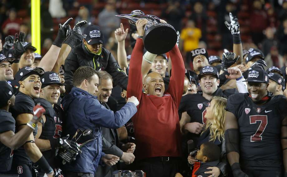 Stanford's head coach David Shaw holds the championship trophy high after beating the USC Trojans 41-22 in the NCAA College PAC-12 Football Championship at Levi Stadium in Santa Clara, Calif., on Saturday December 5, 2015. Photo: Michael Macor, The Chronicle
