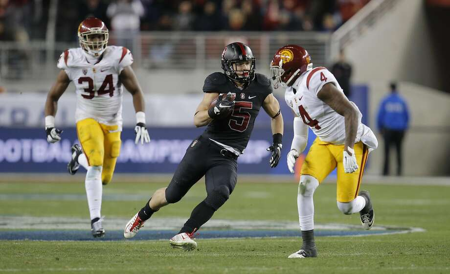 Stanford's Christian McCaffrey, 5 on a long run third quarter is chased by USC's Peter Kalambayi, 34 and Blake Martinez, 4  as Stanford went on to beat on the USC Trojans 41-22 in the NCAA College PAC-12 Football Championship at Levi Stadium in Santa Clara, Calif., on Saturday December 5, 2015. Photo: Michael Macor, The Chronicle