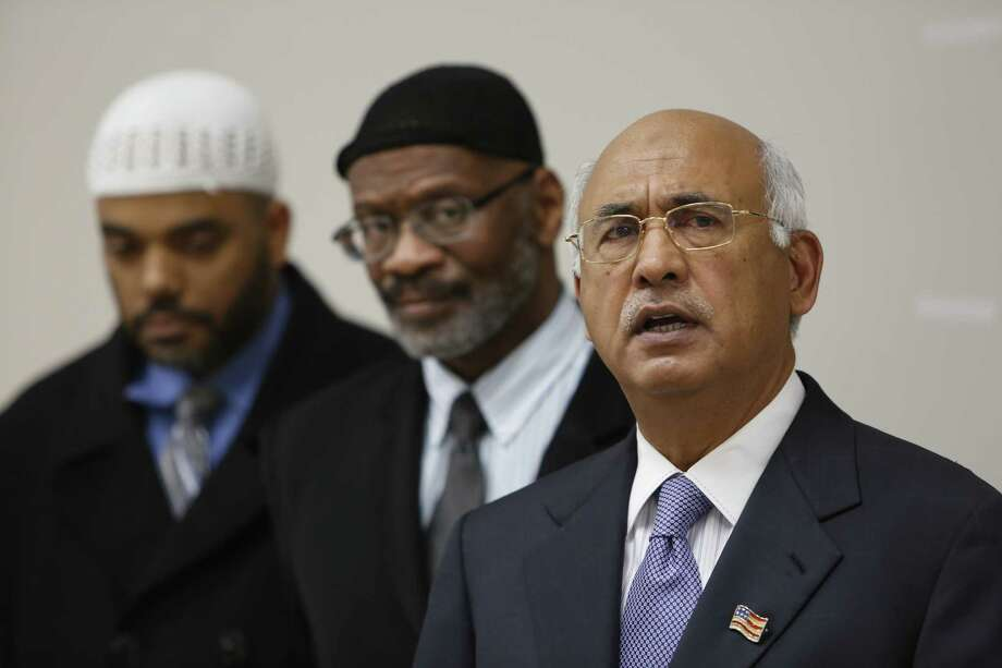 "MJ Khan (right), president of the Islamic Society of Greater Houston: ""A question I keep hearing is 'What will happen to us?'""  Photo: Steve Gonzales, Houston Chronicle / © 2015 Houston Chronicle"