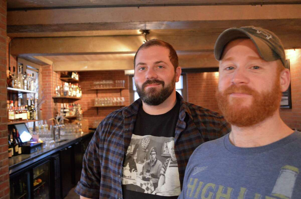 Joe Farrell, left, and Adam Roytman, owners of the new Rothbard Ale + Larder located in the lower level of the old Town Hall building downtown.