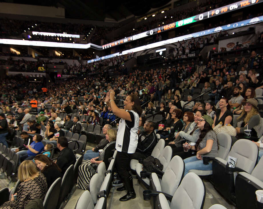 It was a close one for the Spurs Saturday, Dec. 5, 2015, at the AT&T Center as they just barely put down the Boston Celtics 108-105. Here is a look at the fans who cheered on the boys in Silver and Black. Photo: By Kay Richter, For MySA.com