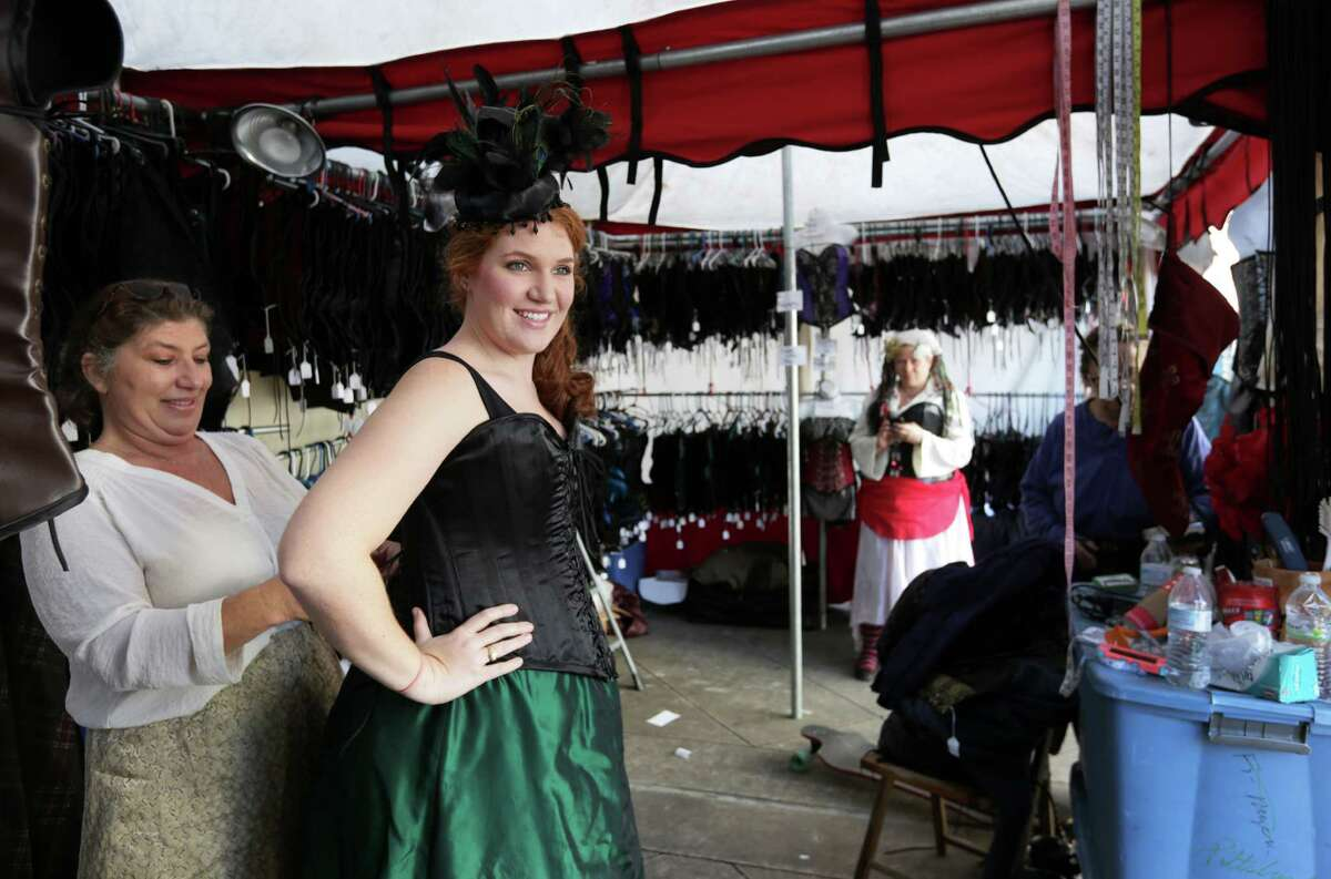 PHOTOS: Dickens on the Strand in Galveston Rachael Patton tries on a corset for the first time with the help of Pam Johnson, in Corsets by Casta Diva, at Dickens on the Strand Sunday, Dec. 6, 2015, in Galveston. Step back to Victorian London at Dickens on the Strand in the following slideshow...