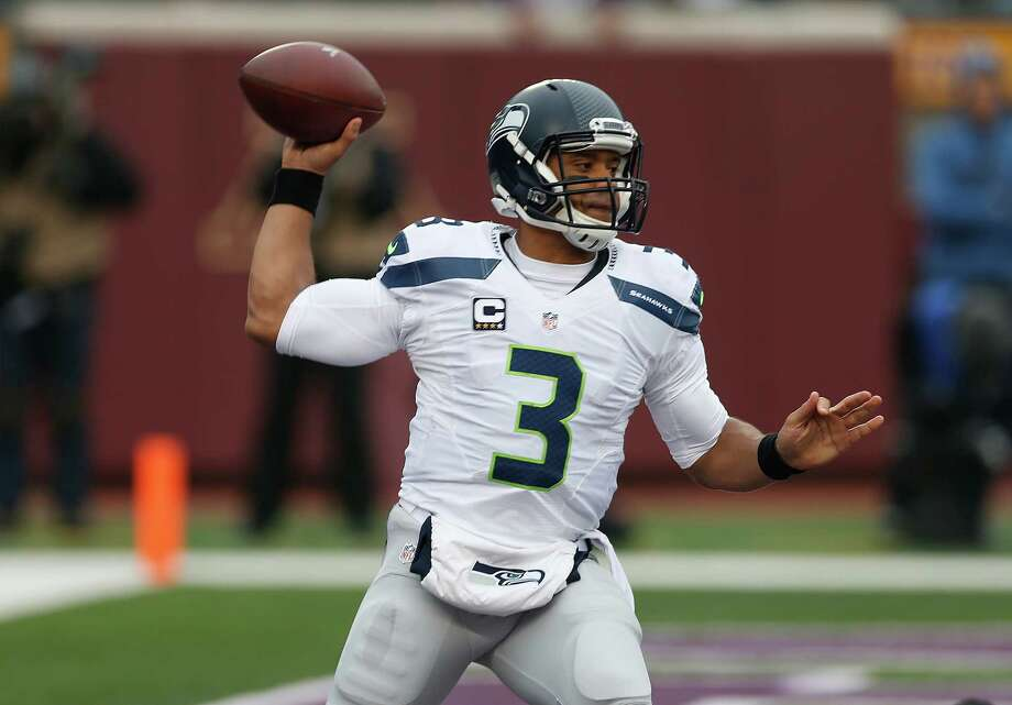 Seattle Seahawks quarterback Russell Wilson (3) throws against the Minnesota Vikings in the first half of an NFL football game Sunday, Dec. 6, 2015 in Minneapolis. (AP Photo/Jim Mone) Photo: Jim Mone, Associated Press / AP