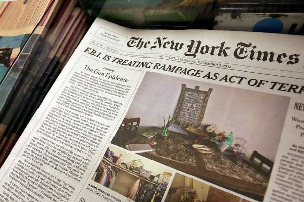 "In this photo, an editorial appears on the front page of the New York Times, at a newsstand in New York, Saturday, Dec. 5, 2015. The New York Times is using space on its front page to call for greater gun regulation in the wake of recent deadly mass shootings. Publisher Arthur Sulzberger Jr. says the newspaper is running its first Page 1 editorial since 1920 to ""deliver a strong and visible statement of frustration and anguish about our country's inability to come to terms with the scourge of guns."""
