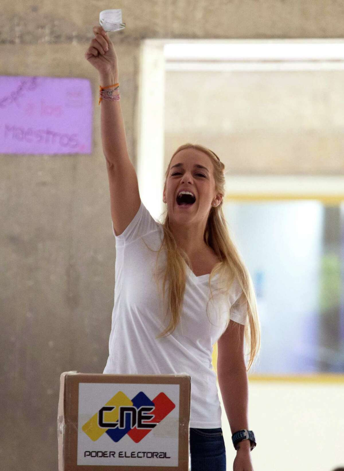Lilian Tintori, the wife of jailed opposition leader Leopoldo Lopez, yells in Spanish: