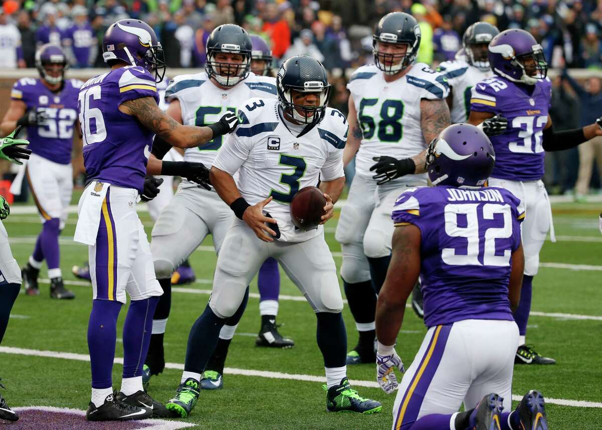 Seattle Seahawks quarterback Russell Wilson (3) celebrates his eight-yard touchdown run against the Minnesota Vikings in the first half of an NFL football game Sunday, Dec. 6, 2015 in Minneapolis. (AP Photo/Ann Heisenfelt)