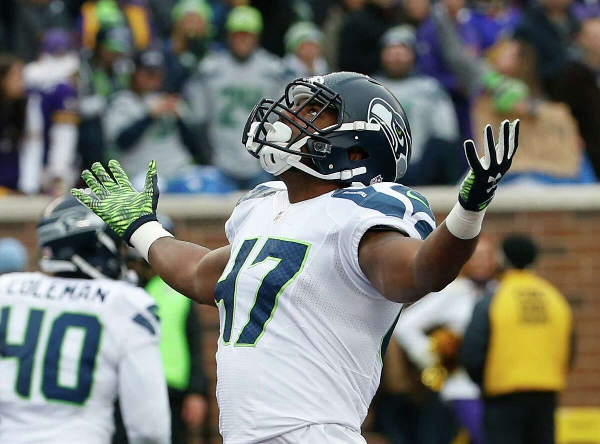 Seattle Seahawks linebacker Eric Pinkins (47) celebrates a tackle against the Minnesota Vikings in the first half of an NFL football game Sunday, Dec. 6, 2015 in Minneapolis. (AP Photo/Ann Heisenfelt)