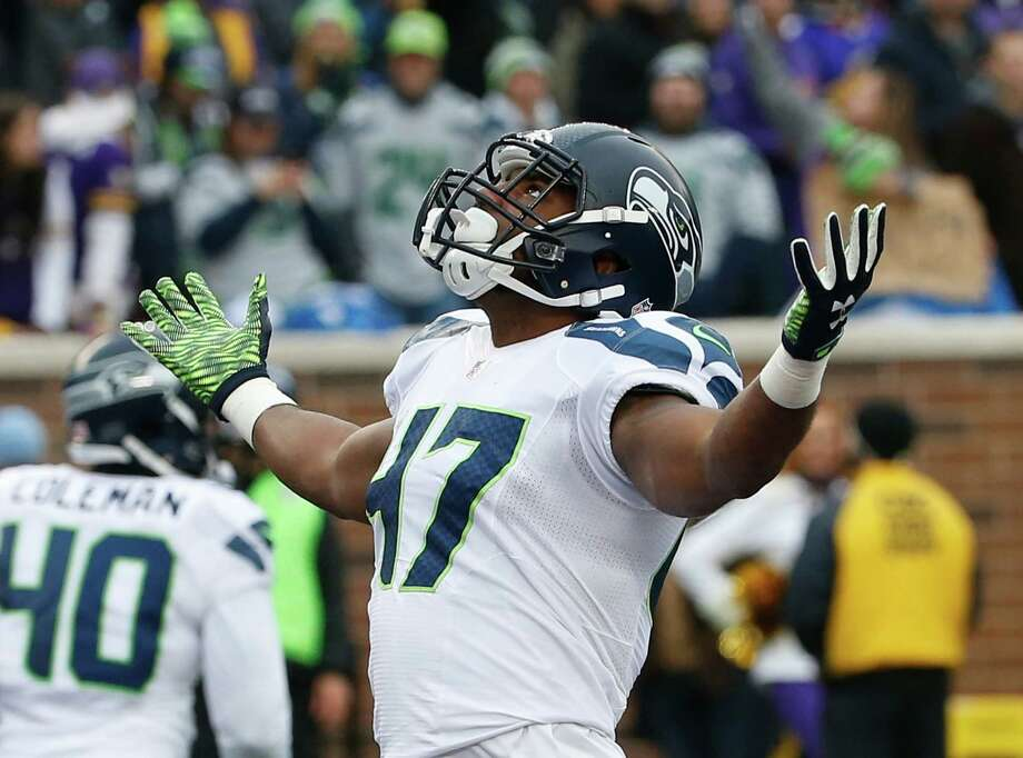 Seattle Seahawks linebacker Eric Pinkins (47) celebrates a tackle against the Minnesota Vikings in the first half of an NFL football game Sunday, Dec. 6, 2015 in Minneapolis. (AP Photo/Ann Heisenfelt) Photo: Ann Heisenfelt, Associated Press / FR13069 AP