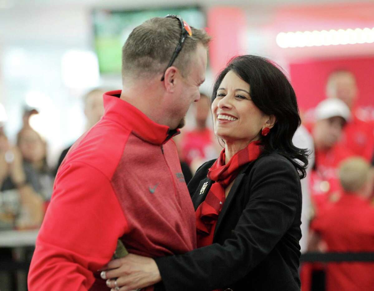 University of Houston system chancellor Renu Khator hugs head football coach Tom Herman at a bowl-selection watch party in the TDECU Stadium club Sunday, Dec. 6, 2015, in Houston. Houston will play Florida State in the Chick-fil-A Peach Bowl on Dec. 31.