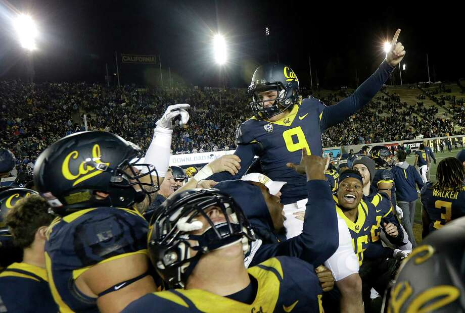California place kicker Matt Anderson (9) is lifted by teammates after kicking the game-winning field goal against Arizona State during the second half of an NCAA college football game in Berkeley, Calif., Saturday, Nov. 28, 2015. California won 48-46. (AP Photo/Jeff Chiu) Photo: Jeff Chiu / Associated Press / AP