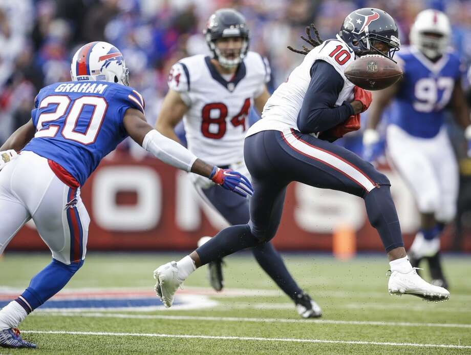 Houston Texans wide receiver DeAndre Hopkins (10) drops a pass defended by Buffalo Bills free safety Corey Graham (20) during the second quarter of an NFL football game at Ralph Wilson Stadium on Sunday, Dec. 6, 2015, in Orchard Park, N.Y. ( Brett Coomer / Houston Chronicle ) Photo: Houston Chronicle