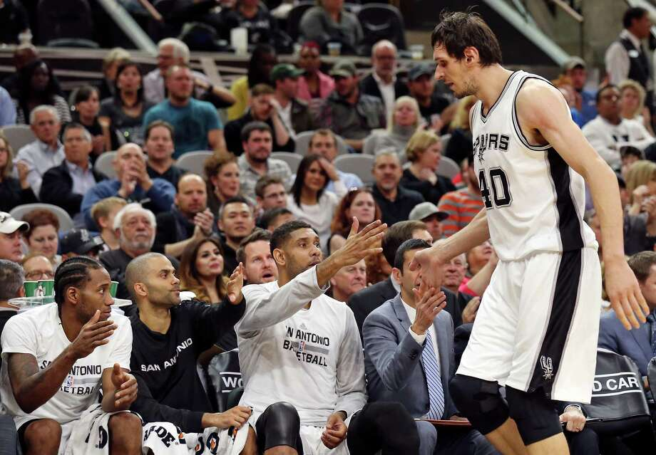 San Antonio Spurs' Kawhi Leonard (from left), Tony Parker, Tim Duncan, and assistant coach James Borrego, greet Boban Marjanovic on the bench during first half action Monday Nov. 23, 2015 at the AT&T Center. Photo: Edward A. Ornelas, Staff / San Antonio Express-News / © 2015 San Antonio Express-News