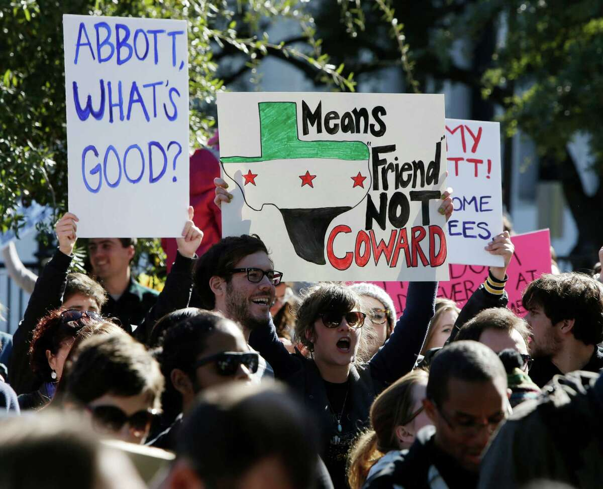 Members of the Syrian People Solidarity Group protest in Austin last month against Gov. Greg Abbott's refusal to allow Syrian refugees to come into Texas.