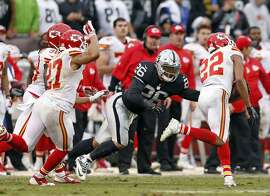 Oakland Raiders' Roy Helu, Jr. can't tackle Kansas City Chiefs' Marcus Peters as Peters returns a 4th quarter interception during Kansas City's 34-20 win in NFL game at O.co Coliseum in Oakland, Calif., on Sunday, December 6, 2015.