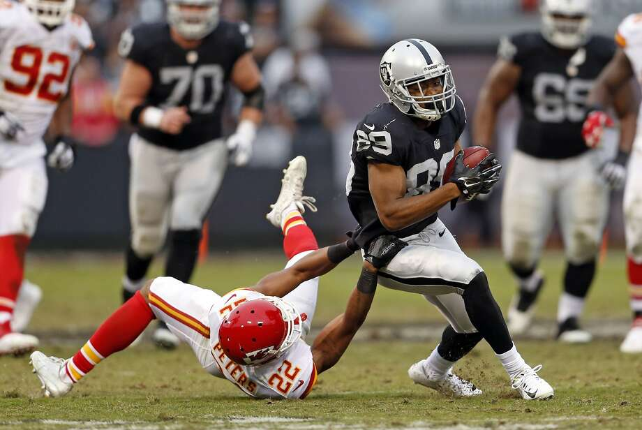 Oakland Raiders' Amari Cooper tries to get away from Kansas City Chiefs' Marcus Peters in 3rd quarter during Kansas City's 34-20 win in NFL game at O.co Coliseum in Oakland, Calif., on Sunday, December 6, 2015. Photo: Scott Strazzante, The Chronicle